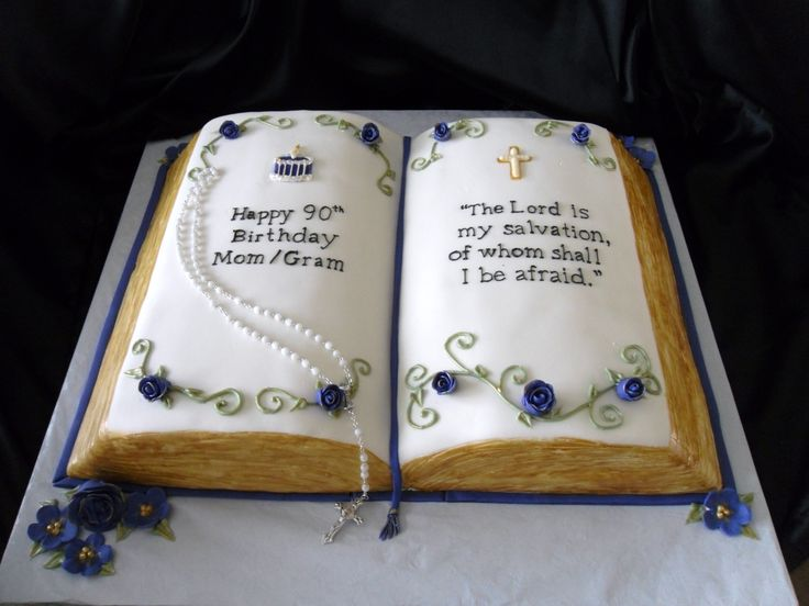 Open Bible - This bible was hand carved from three 1/4 sheet cakes. Covered in MMF. Buttery yellow cake with raspberry filling.