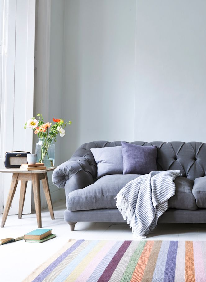 Loaf's comfy grey linen Bagsie chesterfield sofa in this light and airy living room
