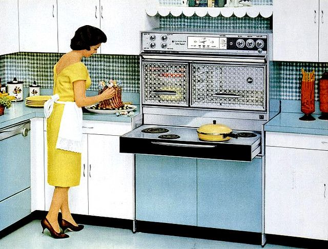 KItchen (1962). This was like the electric range in our first house, '75. Cooktop slid out for use. Oven above and metal cabinets below. Hated it...so happy when we installed our gas range! What memories!