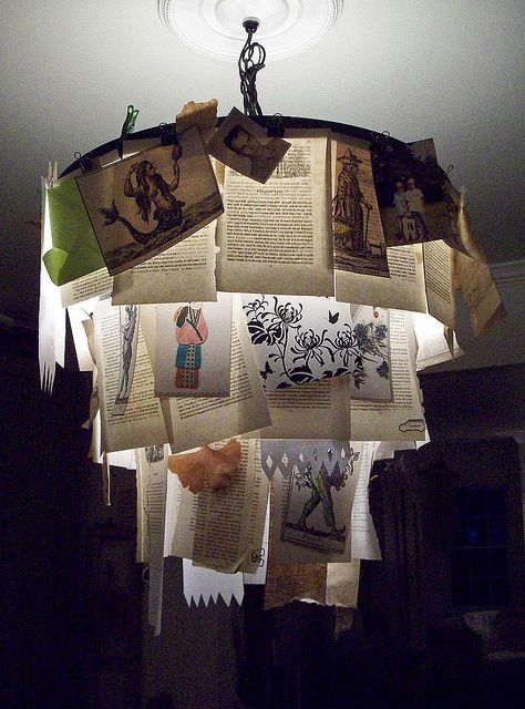 Chandelier made with old photos, children drawings, cherished pieces of paper, old books pages...