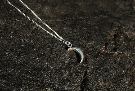 Handmade charm necklace with crescent moon pendant.
