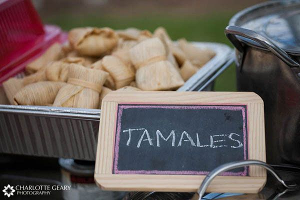 Homemade tamales with a chalkboard sign