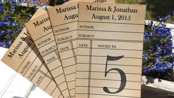 Check out this item in my Etsy shop https://www.etsy.com/ca/listing/188737112/library-card-wedding-table-number