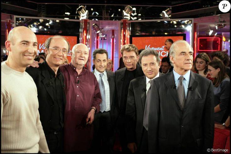 Philippe Geluck et Jean-Pierre Coffe entourés de Nicolas Canteloup, Nicolas Sarkozy, Johnny Hallyday, Michel Drucker et Jean-Pierre Elkabbach dans Vivement Dimanche en 2004.