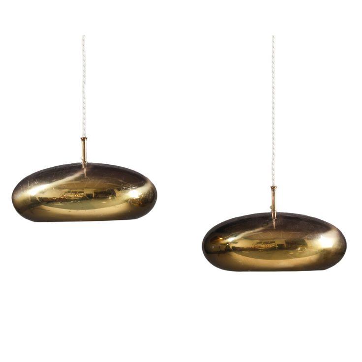 Pendants in brass by Falkenberg Belysning