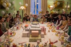 The film's pastel palette during the 1930s scenes was dictated by Anderson. The mint room that hosts this birthday party is one of the many candy-color spaces featured throughout the picture.