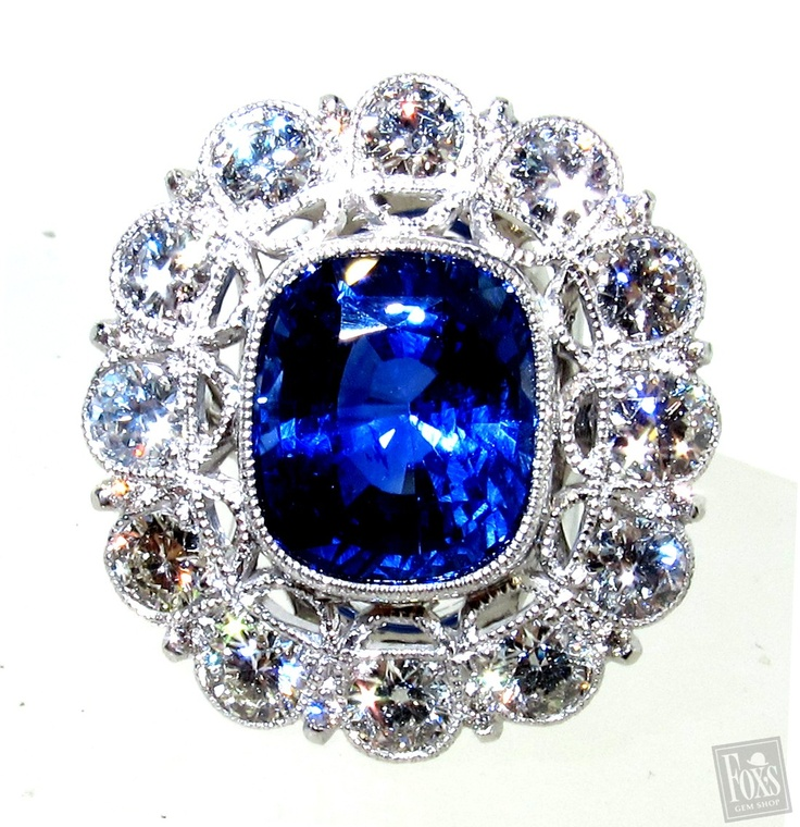 18K WHITE GOLD SAPPHIRE & DIAMOND RING. 1 CUSHION-CUT SAPPHIRE (5.92CT GIA CERTIFIED) & 24 ROUND DIAMONDS (2.68CT TW G COLOR VS-SI1 CLARITY)