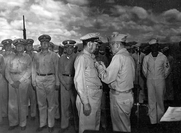 Photo taken on 16 February 1943 as Admiral William Halsey pins the Navy Cross on Admiral Willis Augustus Lee for his leadership and victory during the Battle at Guadalcanal on November 14-15, 1942. The ceremony was held on the Washington (BB-56).