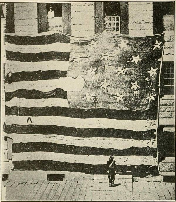 """The original """"Star Spangled Banner"""" that flew over Fort McHenry. Photograph by George Henry Preble, circa 1873."""