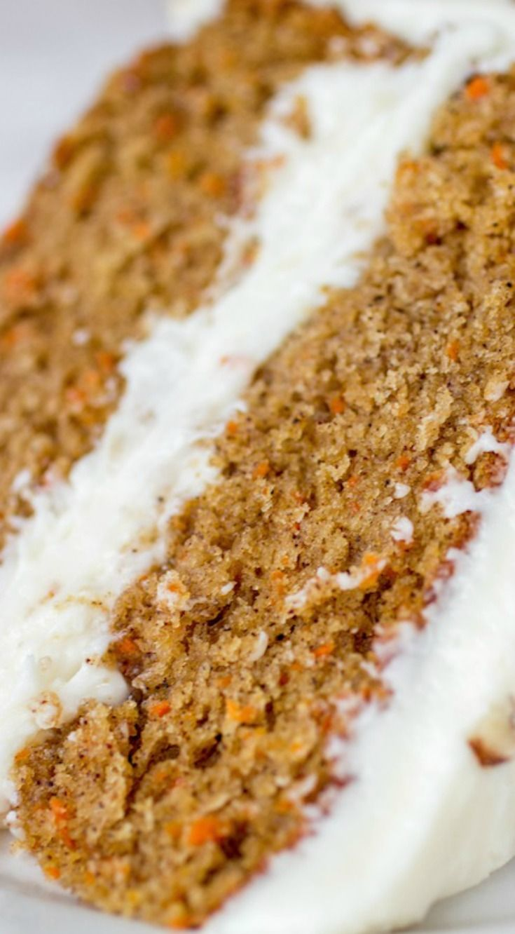 The Best Carrot Cake ~ This homemade cake is extremely moist and flavorful with a hefty coating of cream cheese frosting!