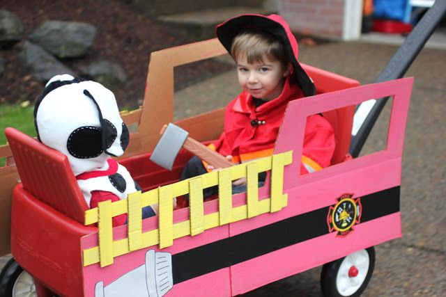 kid firefighter with fire engine costume from wagon.  Think I could spray Jasper white and give him spots?