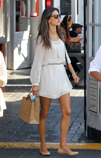 Alessandra Ambrosio cinched her sheer Ella Moss LWD with a gold skinny belt, then added delicate accents for an overall pretty effect. Her long gem pendant necklace and chain-embellished nude flats were low-key, albeit feminine, choices that reflected her girlie bohemian style._ Pop Sugar