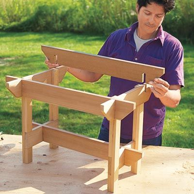 Mark Powers places the stretchers over the notches of the hypertufa table crosspieces