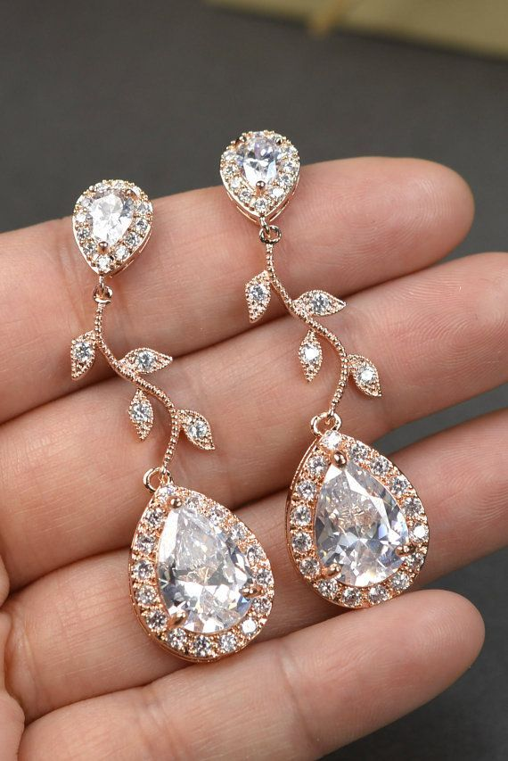 Rose gold Crystal Bridal earrings Wedding jewelry set Wedding Bridal jewelry chandelier dangle Drop Earring bridal necklace bracelet Please see drop down menu on the right of the listing for all price .  ♥EARRINGS : - available in rose gold or yellow gold or white gold (silver ) plated -tear drop rhinestone cubic zirconia Ear Post (No Allergy,Tarnish Resistant) - cubic zirconia -earrings are about 1.75 in long  - Earrings come with posts /studs for pierced ears .I can make earrings with ...