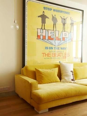 Yellow velvet couch with very big Beatles poster with yellow background - fab I LOVE THE POSTER!!!!!