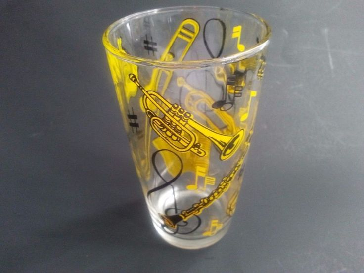 VINTAGE DRINKING GLASS WITH HANDPAINTED BLACK & YELLOW MUSICAL INSTRUMENTS
