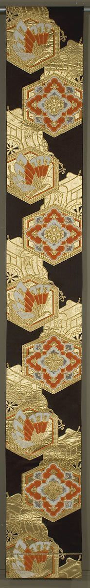 """Japanese Fukuro Obi  12""""x 157""""  Decorated section: 99""""  Dark brown silk ground, brocaded with gold, silk and silver medallions and carts."""