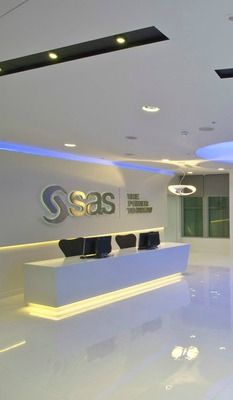The reception area at SAS Software really has the 'wow factor'. The high-gloss finish to the floor, walls and reception desk is enhanced by clever strip lighting around the perimeter walls and furniture. A sleek, oversized corner sofa wraps effortlessly around the space, providing comfort and style to the minimalist, modern décor.