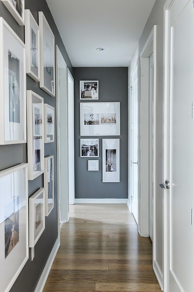 From 'Houzz' this is a clean and open hallway design using B&W photos and white frames to tie the space together, yet not close it in. Keeping all the photography in B&W gives an artsy feel to the space, and the grey walls warm it up. Using wide white picture frame mats helps keep a bright look as well.