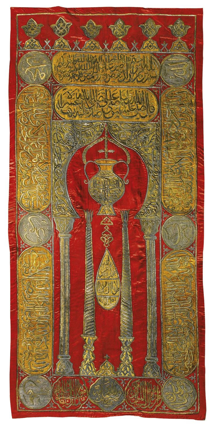 AN OTTOMAN SILK AND METAL THREAD RED-GROUND CURTAIN, TURKEY OR EGYPT, DATED 1295 AH/1878 AD of rectangular form, the red silk ground embroidered throughout with silver and gilt metal threads, the calligraphic cartouches with ochre-coloured silk drops between silver-thread roundels, featuring a central stylised mihrab with a hanging lamp flanked by half columns and framed by an archway with foliate spandrels 219 by 138cm.
