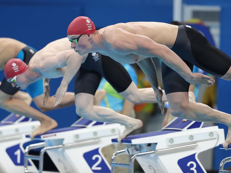 Adam Peaty and Ross Murdoch of Great Britain dive at the start of the men's 100 meter breaststroke heats during the Rio 2016 Summer Olympic Games at Olympic Aquatics Stadium.  Erich Schlegel, USA TODAY Sports
