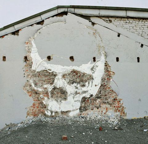 Amazing street art created by chipping away the concrete of a building to reveal the original brickwork. - Imgur