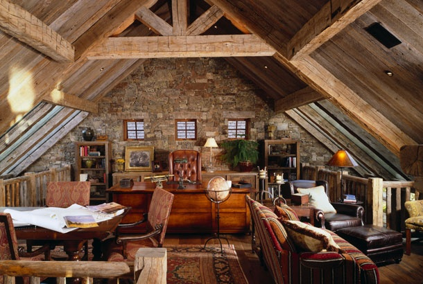 Log cabin loft office. One could take over the world from a desk like that.