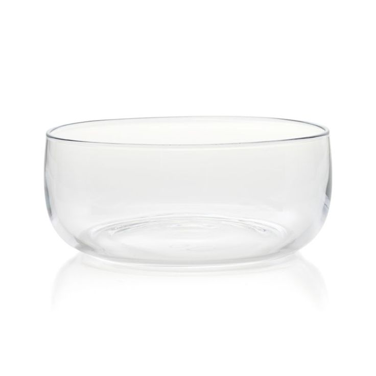 Clear glass bowls have beautiful, clean lines, handcrafted by skilled European glass blowers.  After the bowl is blown in a mold, it is cut to form the rim that is fire polished for a smooth and chip-resistant surface. HandcraftedGlassFood safeHand washMade in Poland.