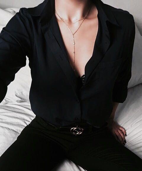 black button down, black pants, and black lace bralette. minimalist outfit.
