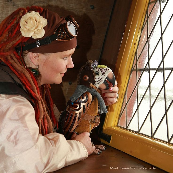 lady and a steampunk parrot on a pirateship by roel.lemstra