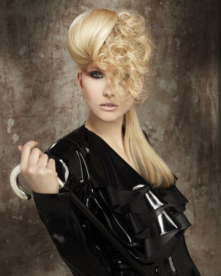 Golden blonde, dual textured hair up. Soft curls against smooth, glossy dressed hair.   Hair by Steven Smart, make up by Debra Smart, photography by Barry Jeffery and styling by Bernard Connolly