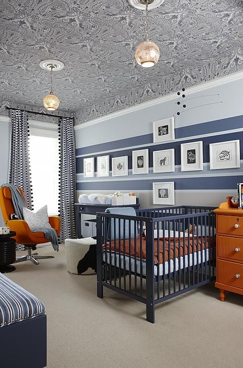 Sophisto-Nursery | Sarah Richardson Design Love the warm blue stripes and the curtains with the ball-fringe.  Sarah R is brilliant!
