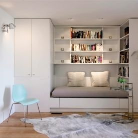 This daybed is a cozy reading nook which can be converted into a queen bed for guests. Photo & design by Michel Laflamme Archtitect.