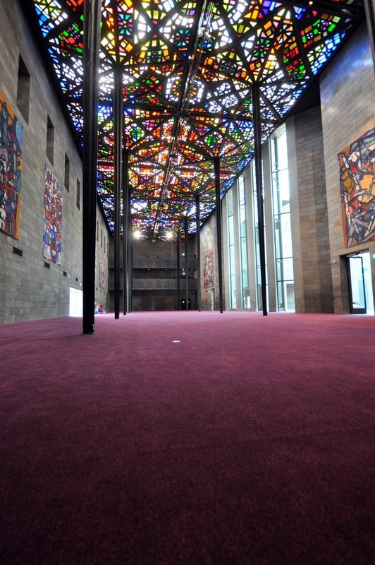 Above Left installation - the great hall at NGV.  EcoSoft Modular Ax carpet tiles.  #leadlight