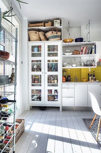 love painted floor boards & the Eames chair & the baskets & pretty much everything about this picture!