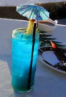 Blue Hawaii:  3/4 oz. Light Rum    3/4 oz. Vodka    1/2 oz. Blue Curacao    3 oz. Pineapple Juice    1 oz. Sweet & Sour Mix