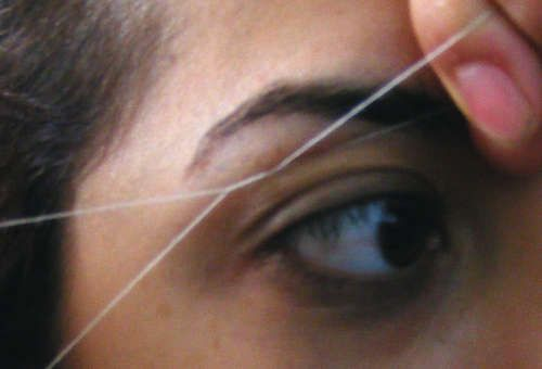 I am addicted to threading! It doesn't hurt as much as waxing and doesn't leave those ugly pink tattoo marks. Besides my brows and upper lip, I thread my entire face to get rid of the peach fuzz.