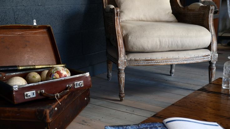 Linen armchair and industrial coffee table