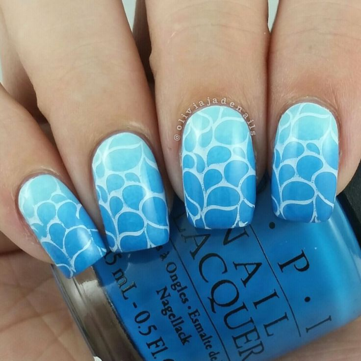 Uberchic Beauty Collection Eight Stamping Plates - Swatches & Review by Olivia Jade Nails. Look at this beautiful blue manicure with nails stamps by UberChic. I love the blue gradient nail art! #UberChicBeauty #UberChic #nailaddict #nailart #bluenails