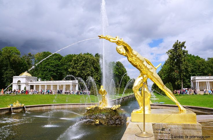 an atheletic golden fountain - part of the Grand Cascade of Peterhof Palace in St. Petersburg, Russia