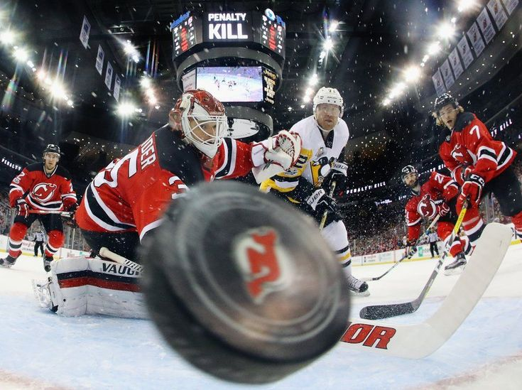 A puck flies towards the camera.