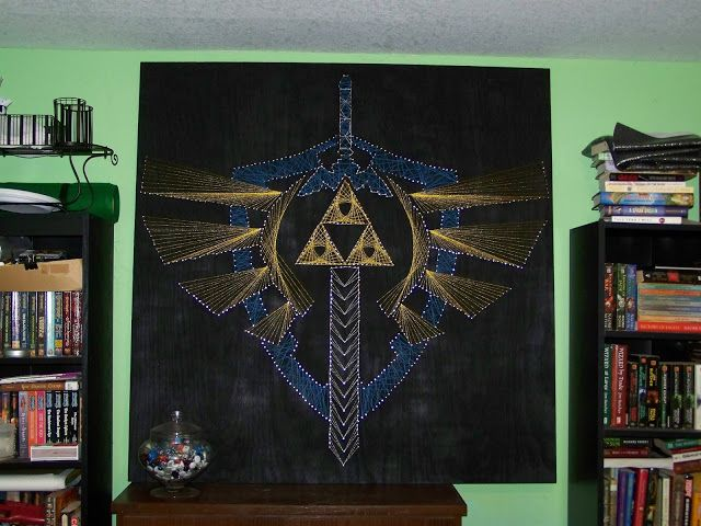 After months of work, I have finished my giganticstring art project.   The last stage of the Hylian Crest design was the wings and trif...