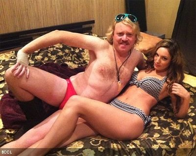 Kelly Brook in bed with Leigh Francis! as they shoot a steamy scene for 'Keith Lemon: The Movie'!