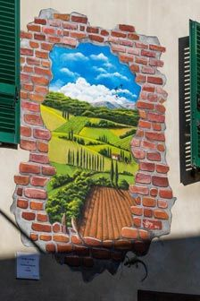 MUGNANO, Perugia, Umbria. The peculiarity of these murals lies in reproducing most of the times small or large-sized paintings decorating the outer walls of houses.