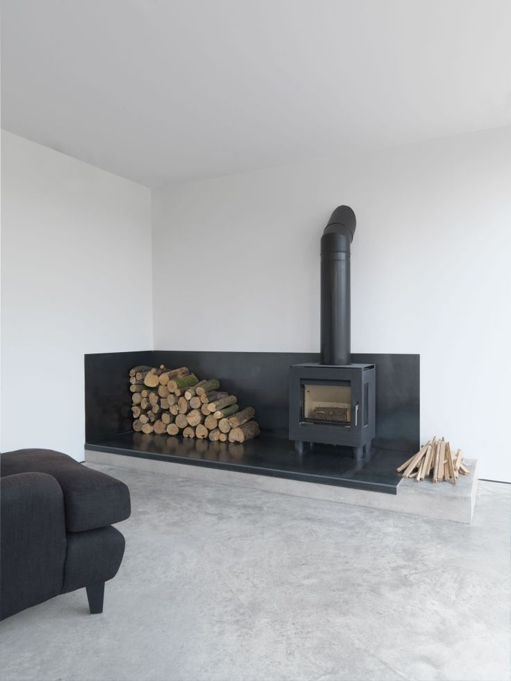 Industrial fire space with stove. Feversham House by McLaren Excell. © Richard Leeney.