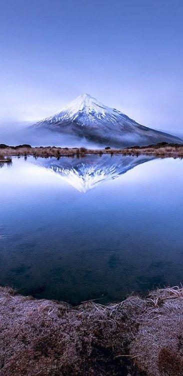 Reflection of Mount Taranaki in the Pouakai Tarns, Taranaki, Mount Egmont National Park, North Island, New Zealand