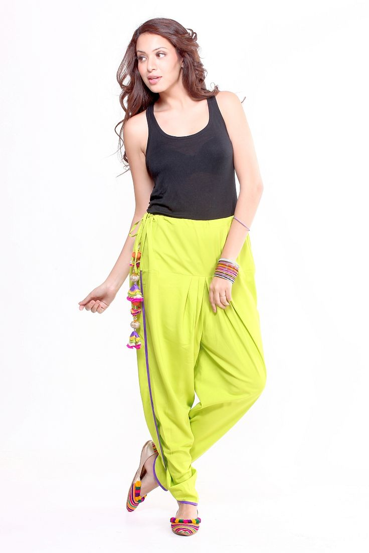 Bring in a bright flare to your wardrobe this summer with these neon green overlapped dhoti pants with tie up belt. They come with a contrast piping all over. Do not be afraid to show off your favourite printe tee or tank top n combination with these pants. A nice pair of strappy sandals, a stole and voila! our boho-chic look is complete.  Material:  Semi Crepe