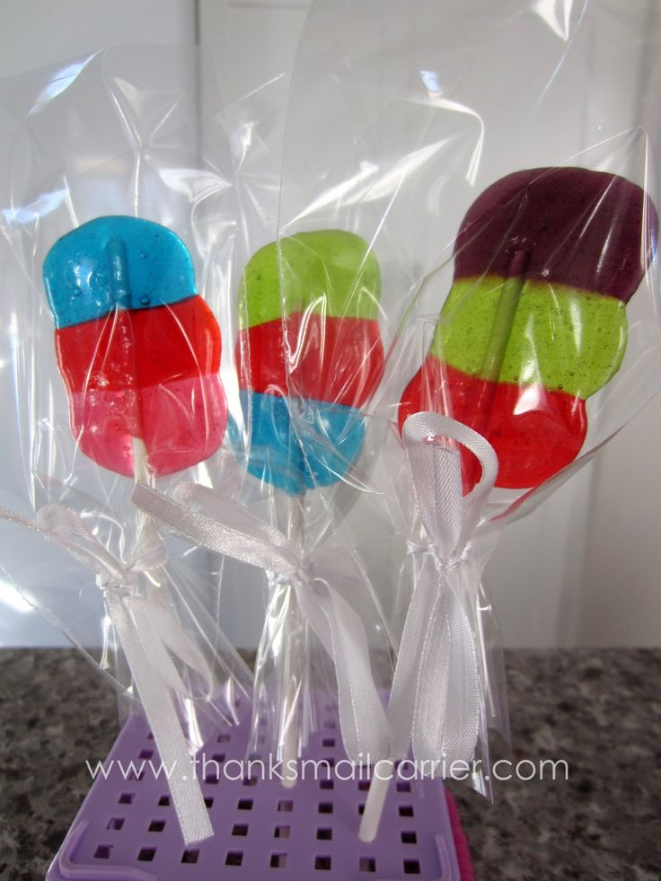 EASY PEASY! DIY lollipops. Jolly Ranchers, lollipop sticks and parchment paper, 275F for 7-9min. Life Savers work well too. I put the sticks into the first color only. They held up great, and look a little more polished. Site gives great instructions.