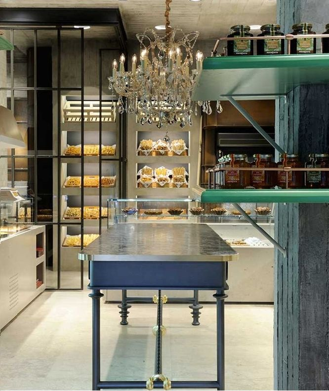 Located in a listed building in the centre of Thessaloniki, Greece, the store belongs to Terkenlis, a historic and famous patisserie and bakery brand