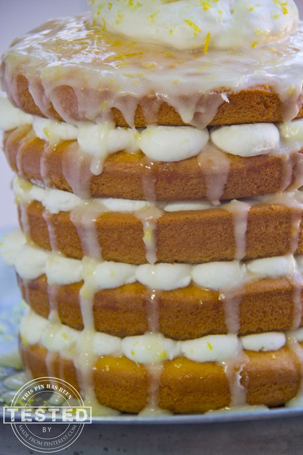 This is just a lemon poke cake, all piled up with whipped cream and drizzled with lemon glaze.